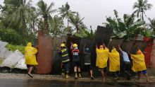 1 dead, 100,000 displaced as typhoon blows near Philippines
