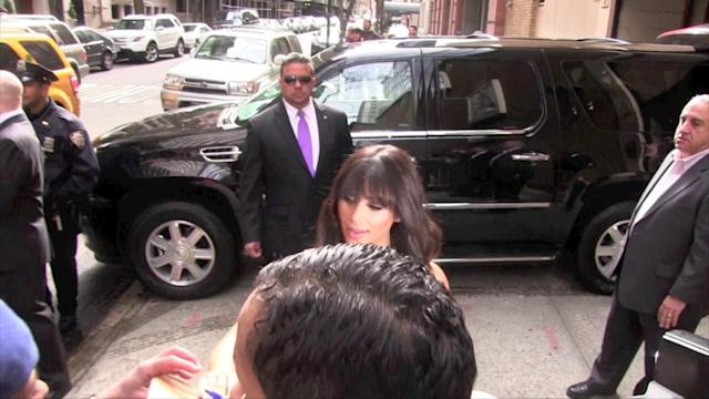 Kim Kardashian Busts Out of Her Maxi Dress