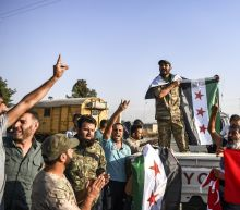 The Latest: Syrian troops deploy toward Raqqa, Turkish front