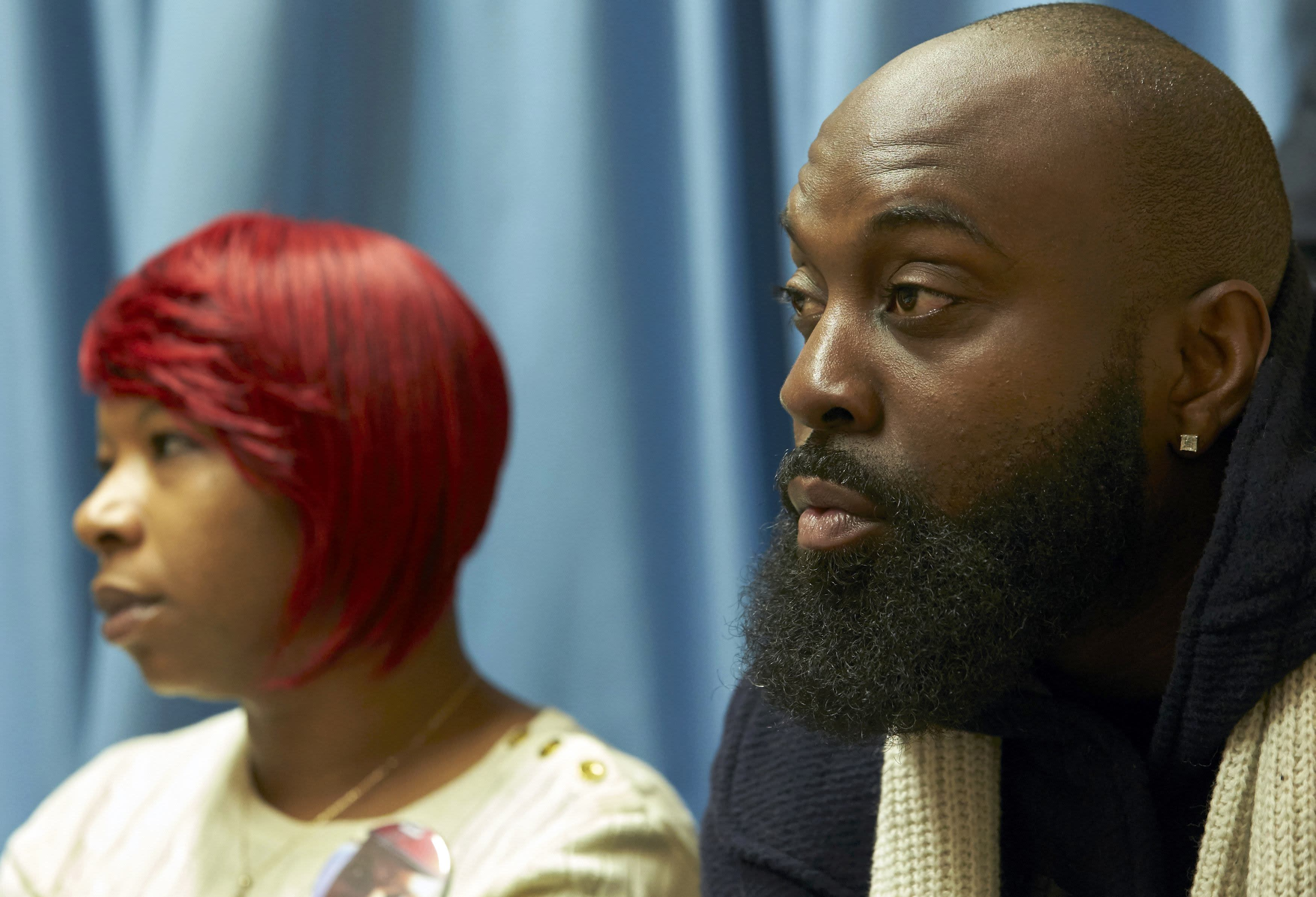 """The mother, Lesley McSpadden (L) and father, Michael Brown Sr., of slain teenager Michael Brown, hold a news conference in Geneva November 12, 2014. The family of the slain Missouri teenager Michael Brown said on Wednesday that they had faith in the pending decision of a grand jury and called for supporters to refrain from violence. Michael Brown Sr. said that he and his wife has come to the United Nations, where they testified to the U.N. Committee against Torture, to seek """"redress"""" for the fatal shooting of their unarmed 18-year-old son in August. REUTERS/Denis Balibouse (SWITZERLAND)"""