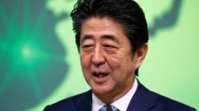 Japanese PM sends offering to war-dead shrine but will not visit - Kyodo