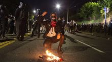 Protesters in Portland, Oregon, clash with police, federal officers during chaotic night