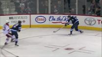 Wheeler locates puck and whips it in