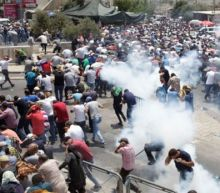 Three Israelis stabbed to death in West Bank settlement after three Palestinians killed in bloody clashes