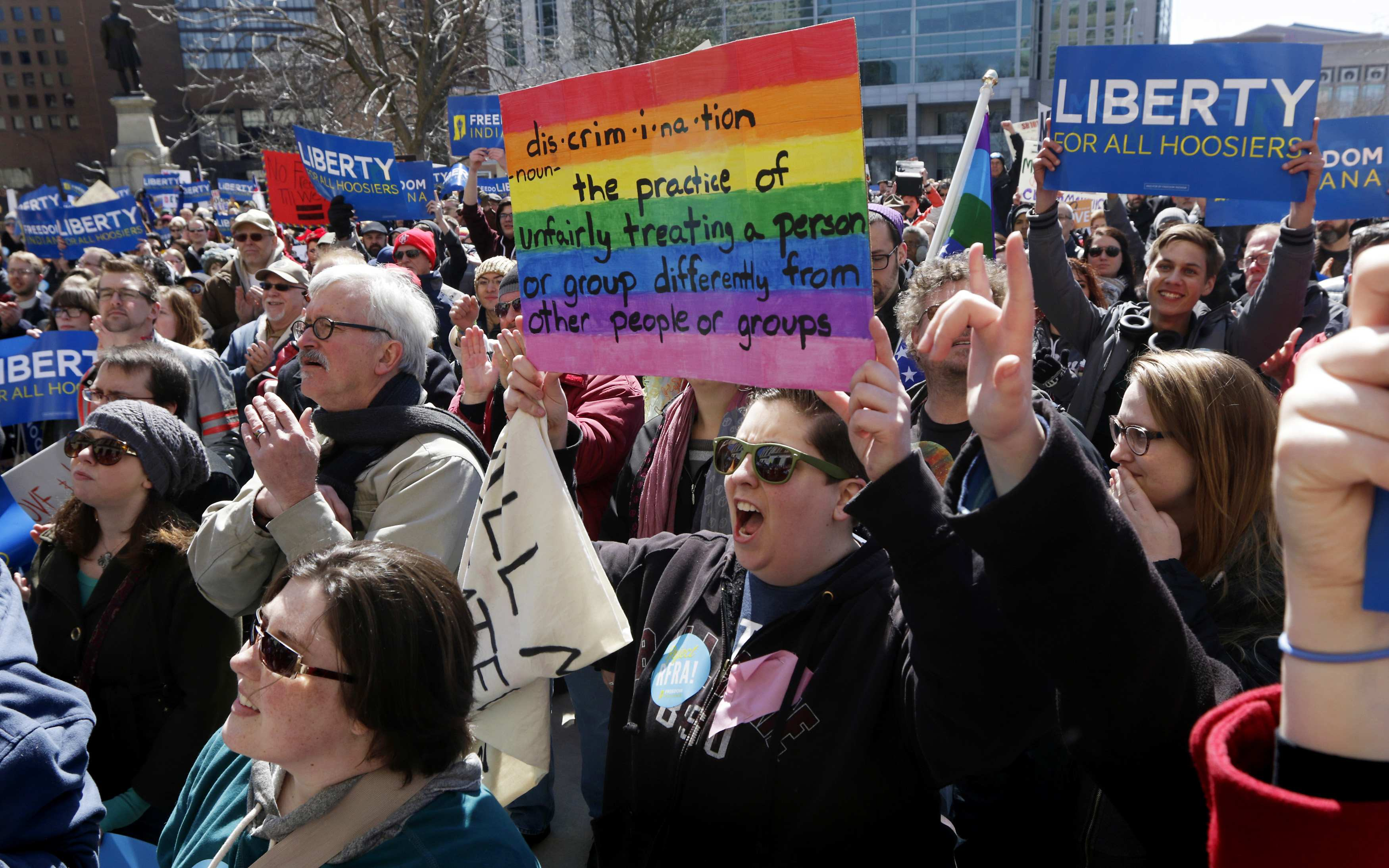 Demonstrators gather at Monument Circle to protest a controversial religious freedom bill recently signed by Governor Mike Pence during a rally in Indianapolis March 28, 2015. More than 2,000 people gathered at the Indiana State Capital Saturday to protest Indiana�s newly signed Religious Freedom Restoration Act saying it would promote discrimination against individuals based on sexual orientation. REUTERS/Nate Chute