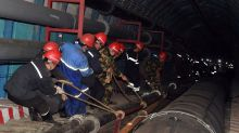 China mine rescue: Crews work to free trapped workers in Xinjiang