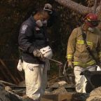 Search crews rush to find wildfire victims before rain moves in