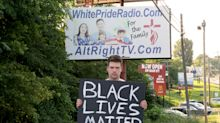 A man held a Black Lives Matter sign in Harrison, Arkansas. He posted the racist responses to YouTube.