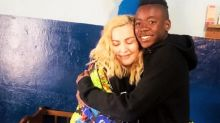Madonna shares touching picture hugging son David as they visit Malawi orphanage she adopted him from