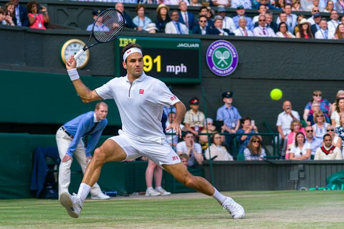 LONDON, ENGLAND - JULY 14: Roger Federer of Switzerland play a forehand in his Men's Singles final against Novak Djokovic of Serbia during Day thirteen of The Championships - Wimbledon 2019 at All England Lawn Tennis and Croquet Club on July 14, 2019 in London, England. (Photo by Andy Cheung/Getty Images)