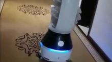 Coronavirus: 'Little Peanut' robot delivers food to people in quarantine in China