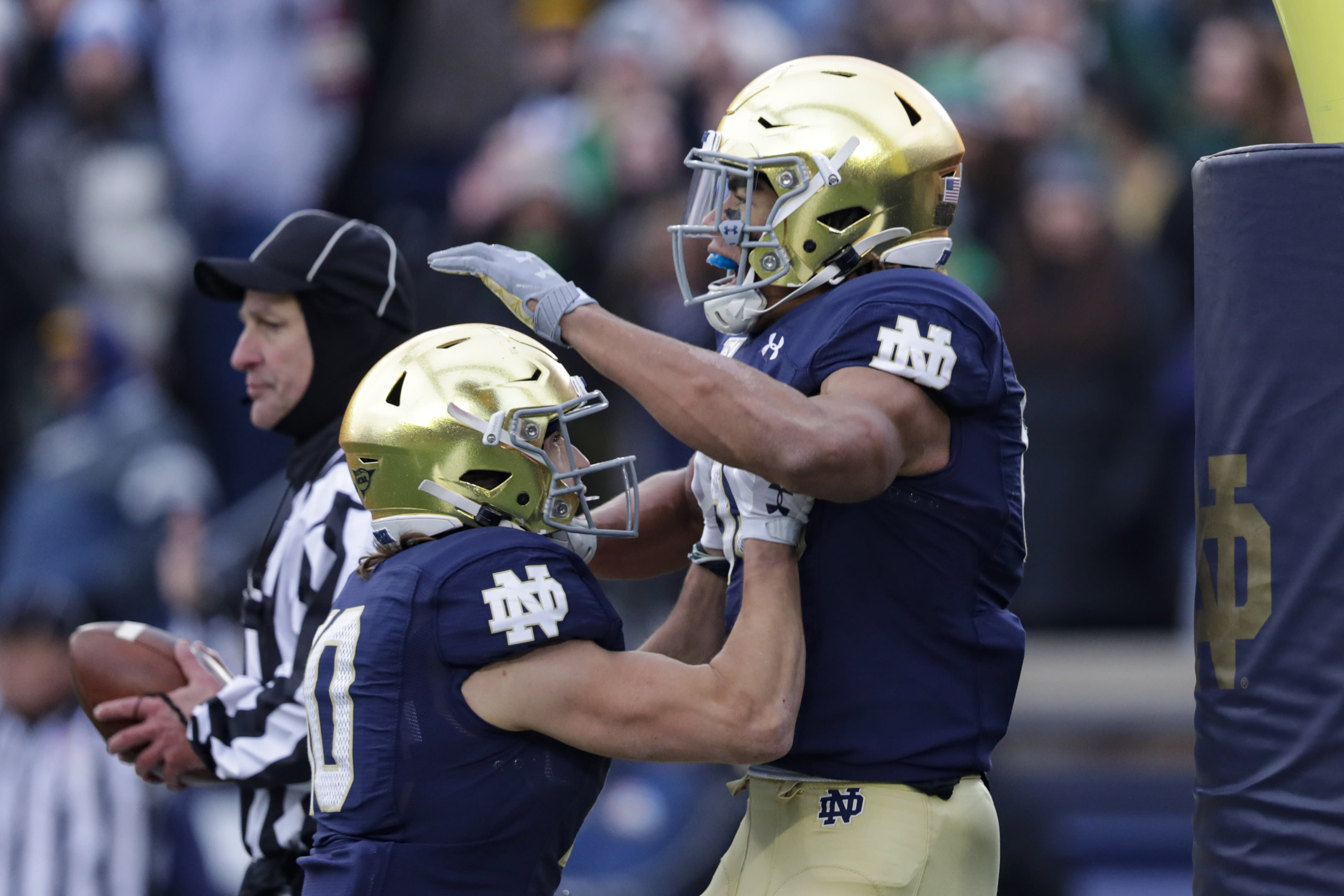 Notre Dame wide receiver Chase Claypool (83) celebrates his touchdown against Boston College with wide receiver Chris Finke (10) during the first half of an NCAA college football game in South Bend, Ind., Saturday, Nov. 23, 2019. (AP Photo/Michael Conroy)
