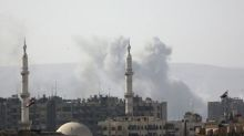 Insurgents south of Syrian capital surrender, says state TV