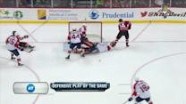 Tim Thomas contorts to make a great save