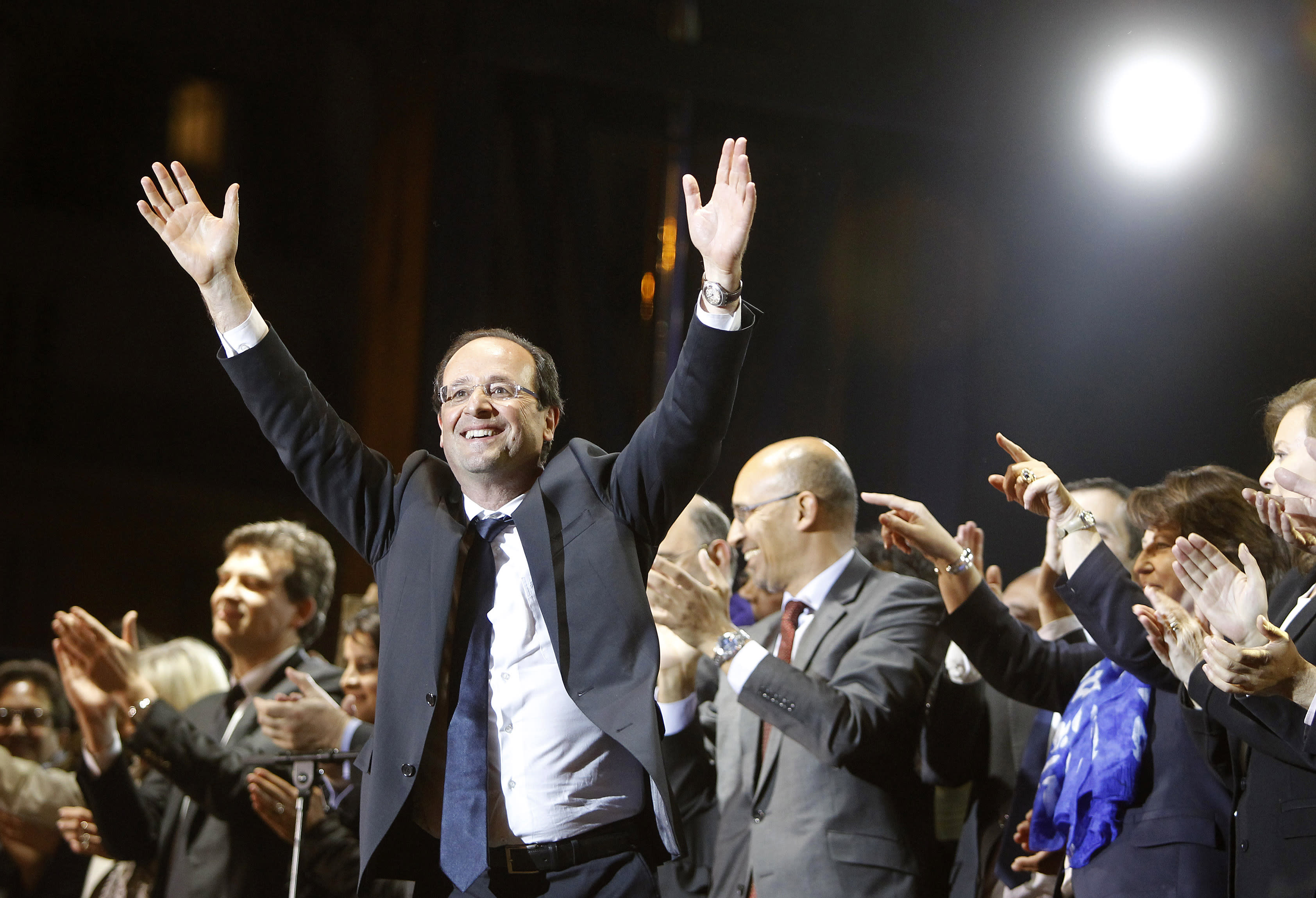 French president-elect Francois Hollande waves to crowds gathered to celebrate his election victory in Bastille Square in Paris, Sunday, May 6, 2012. Hollande defeated outgoing President Nicolas Sarkozy on Sunday to become France's next president, Sarkozy conceded defeat minutes after the polls closed. (AP Photo/Laurent Cipriani)