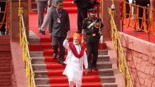 Narendra Modi announces space mission, health scheme as election nears