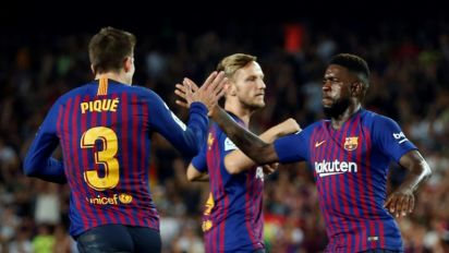 Pique rescues point for 10-man Barca against Girona