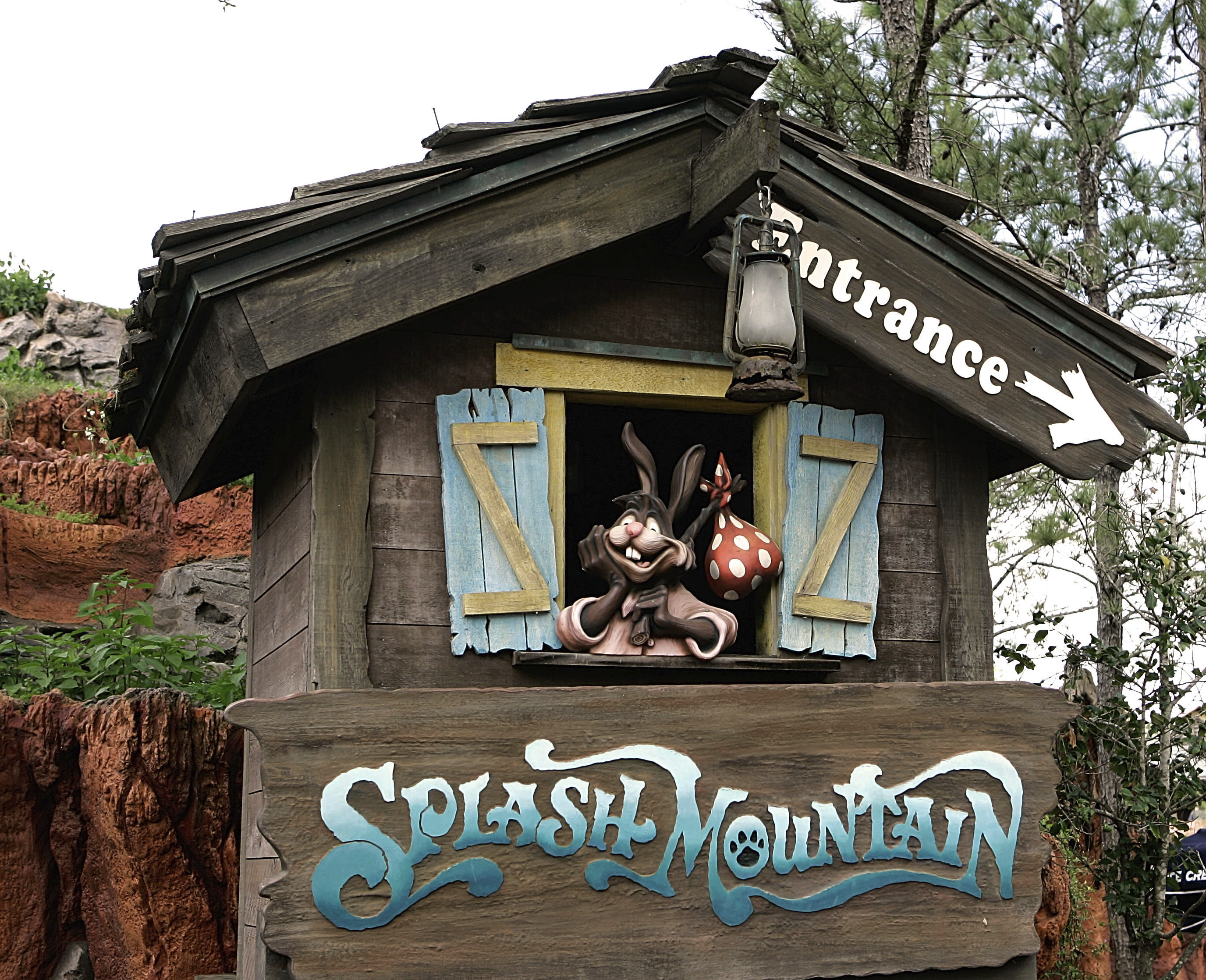 """FILE- In this March 21, 2007 file photo, the character Brer Rabbit, from the movie, """"Song of the South,"""" is depicted near the entrance to the Splash Mountain ride in the Magic Kingdom at Walt Disney World in Lake Buena Vista, Fla. The Splash Mountain ride at Disney parks in California and Florida is being recast. Disney officials said the ride would no longer be tied to the 1946 movie, """"Song of the South,"""" which many view as racist. Instead, the revamped ride will be inspired by the 2009 Disney film, """"The Princess and the Frog,"""" which has an African-American female lead. (AP Photo/John Raoux, File)"""