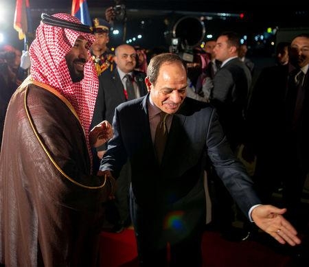 Saudi Arabia's Crown Prince Mohammed bin Salman is welcomed by Egyptian President Abdel Fattah al-Sisi in Cairo, Egypt November 26, 2018. Bandar Algaloud/Courtesy of Saudi Royal Court/Handout via REUTERS