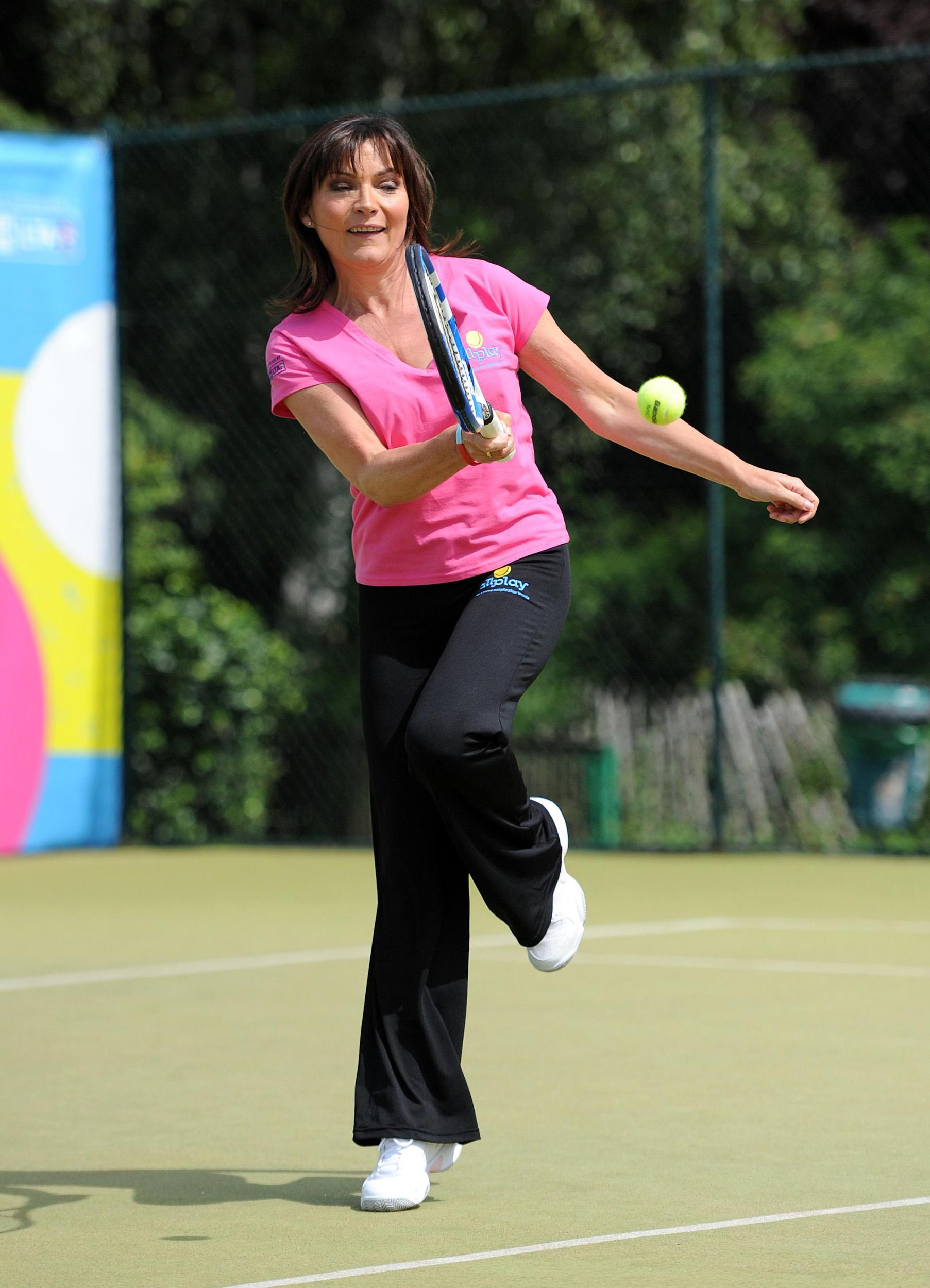Lorraine Kelly plays tennis during the Lawn Tennis Association's campagne All Play, at Wimbledon Park Tennis Courts, Wimbledon.