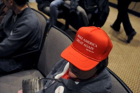 A supporter of U.S. Republican presidential candidate Donald Trump waits for the start of a campaign event at the Bridge View Center in Ottumwa, Iowa, January 9, 2016. REUTERS/Mark Kauzlarich