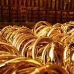 Gold prices move up after brief dip in the wake of a fall in weekly U.S. jobless claims