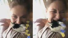 Woman bites cat's head in 'revenge attack on boyfriend'