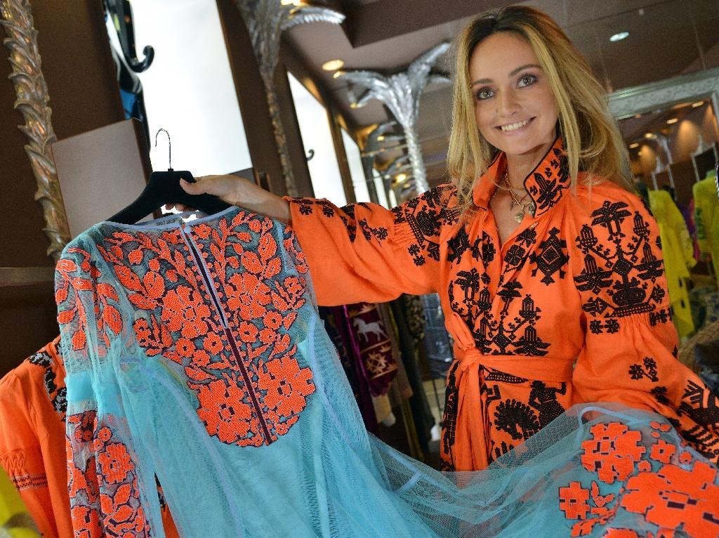 "The style came back out of the closet after Ukraine's 2014 pro-Western revolt pulled the ex-Soviet republic out of Russia's orbit and gave it a new sense of national pride Fashionistas the world over are snatching up a must-have item for the ""boho chic"" look -- an embroidered blouse or dress that is, in fact, Ukraine's national costume and new symbol of unity. Vyshyvanka tops and dresses decorated with colourful embroidery date back centuries, with styles and stitch designs often codified by region and long believed to protect wearers from evil spirts . (AFP Photo/Genya Savilov)"