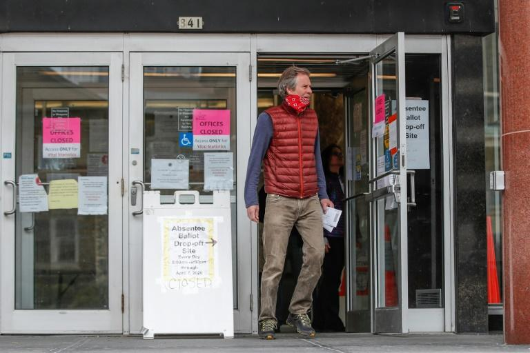 A man leaves the Frank P. Zeidler Municipal Building after not being able to cast his ballot at the already closed drop-off site in Milwaukee, Wisconsin, on April 6 (AFP Photo/KAMIL KRZACZYNSKI)