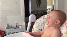 Baby can't control laughter at funny show on TV