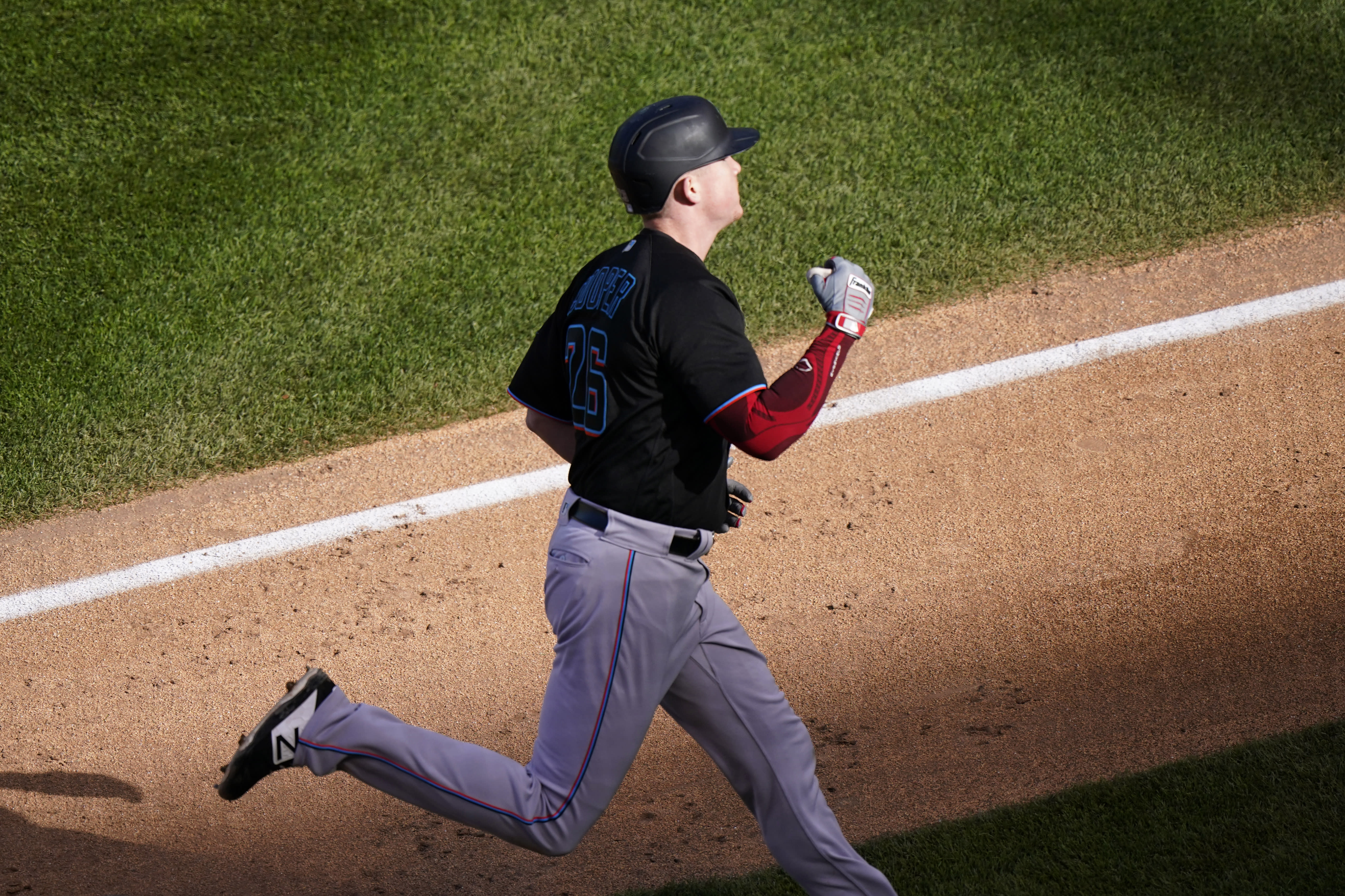 Miami Marlins' Garrett Cooper celebrates as he rounds the bases after hitting a solo home run during the seventh inning in Game 2 of a National League wild-card baseball series against the Chicago Cubs Friday, Oct. 2, 2020, in Chicago. (AP Photo/Nam Y. Huh)