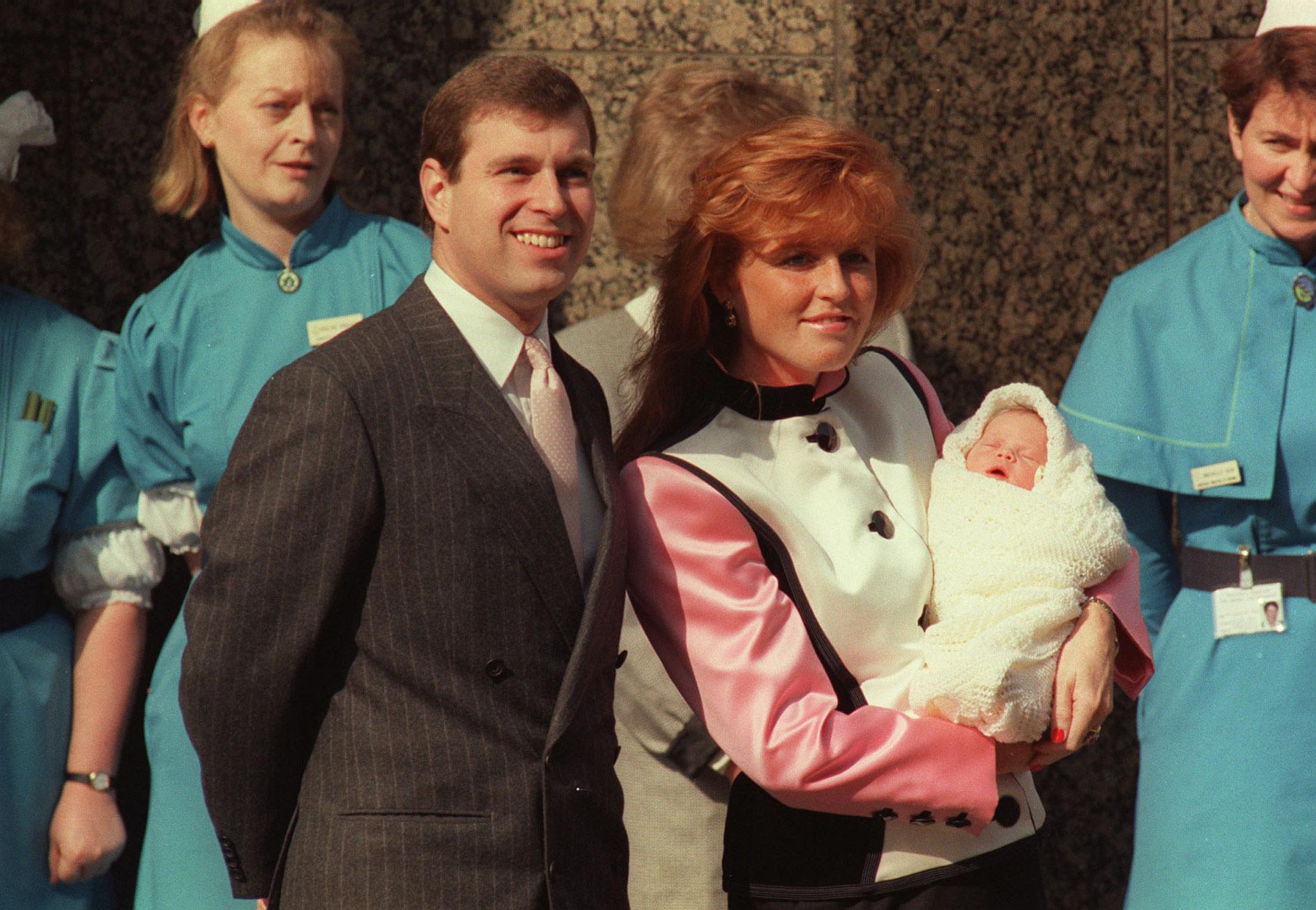The Duke and Duchess of York pause outside the Portland Hospital in London with the duchess holding their new daughter Princess Eugenie Vistoria Helena.
