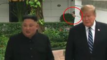 Who is the mysterious woman lurking in the background of Trump and Kim's summit pics?