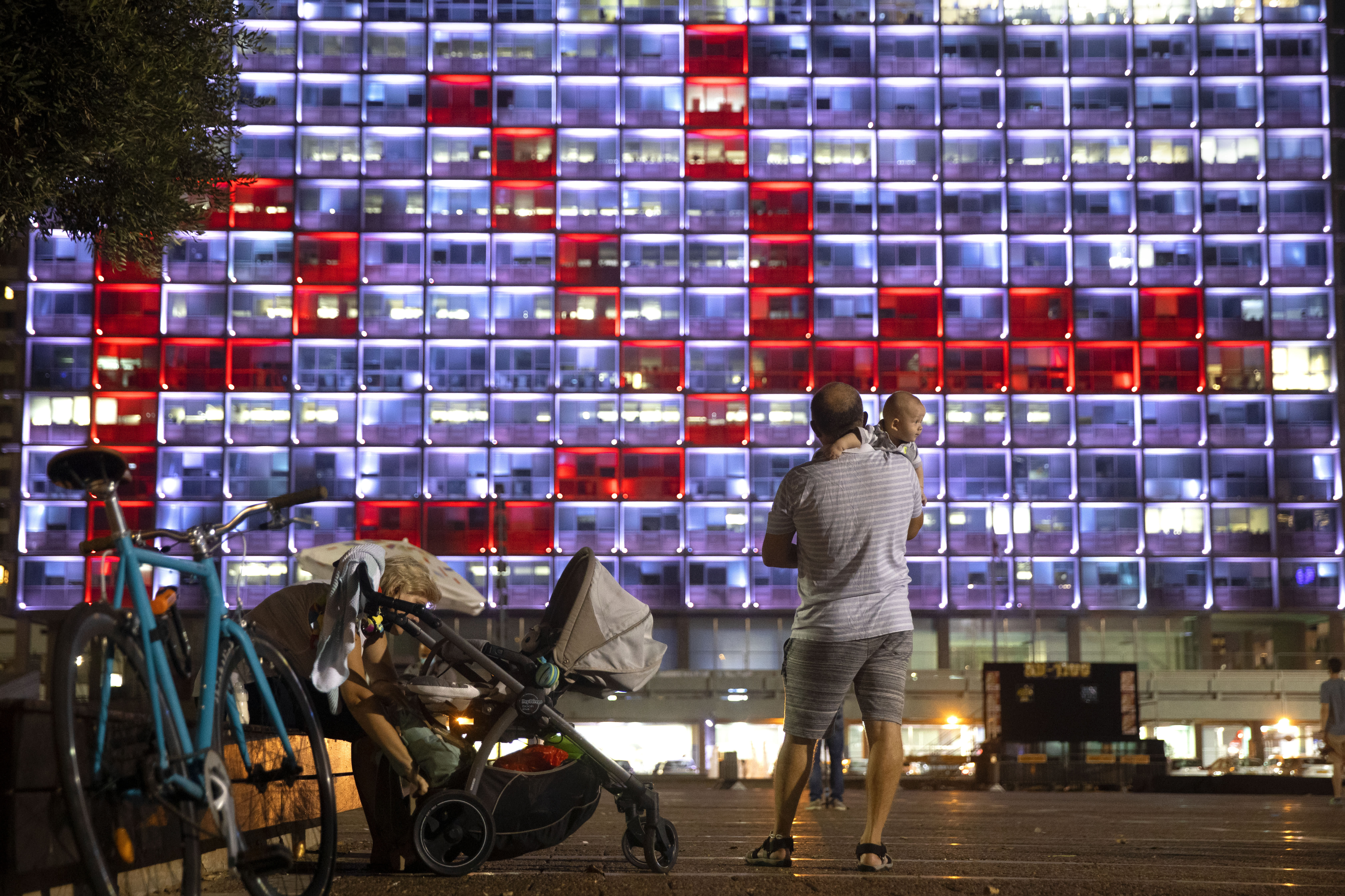Tel Aviv City Hall is lit up with the words for peace in Hebrew, Arabic and English in honor of the recognition agreements Israel will be signing with the United Arab Emirates and Bahrain at the White House, in Tel Aviv, Israel, Tuesday, Sept 15, 2020. (AP Photo/Oded Balilty)