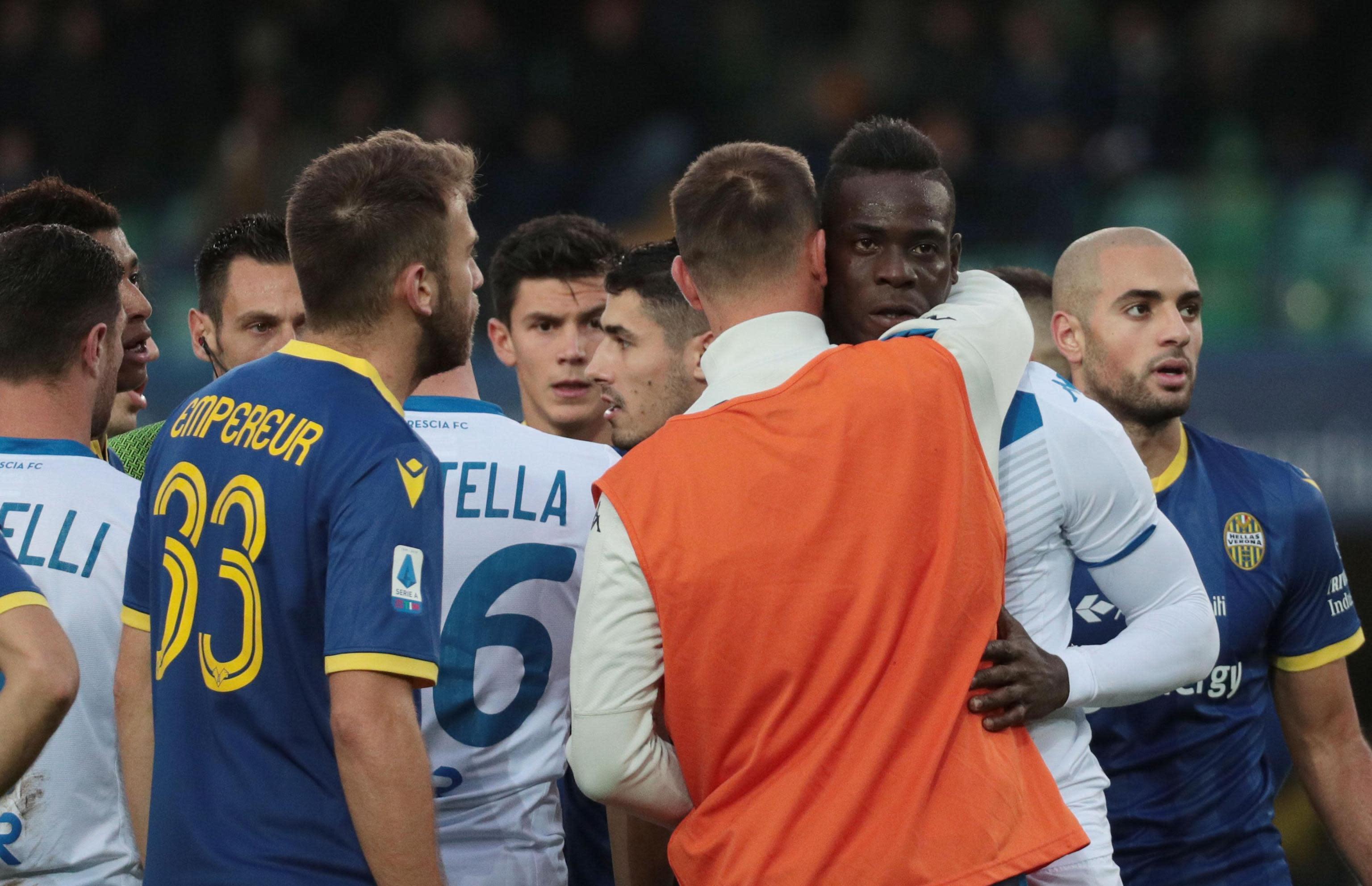 Brescia's Mario Balotelli, second from right, reacts to Verona supporters' racist chants during the Italian Serie A soccer match between Verona and Brescia at the Bentegodi stadium in Verona, Italy, Sunday, Nov. 3, 2019. (Simone Venezia/ANSA via AP)