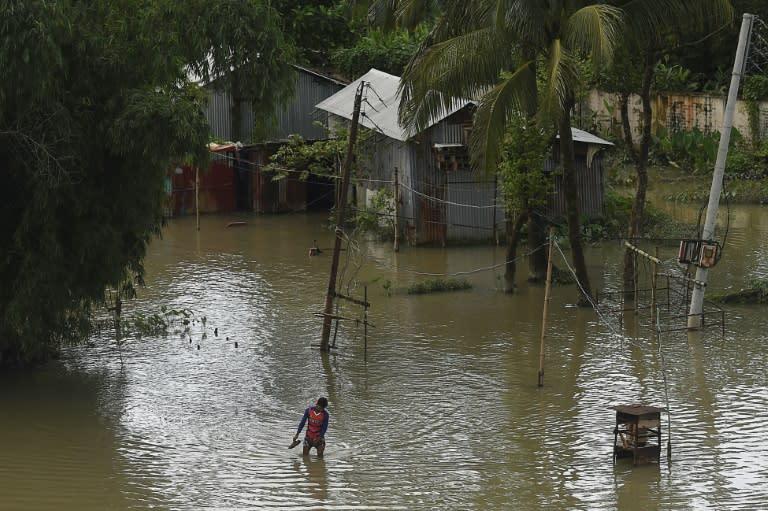 Torrential monsoon rains have unleashed havoc in India, Bangladesh and Nepal (AFP Photo/Munir UZ ZAMAN)