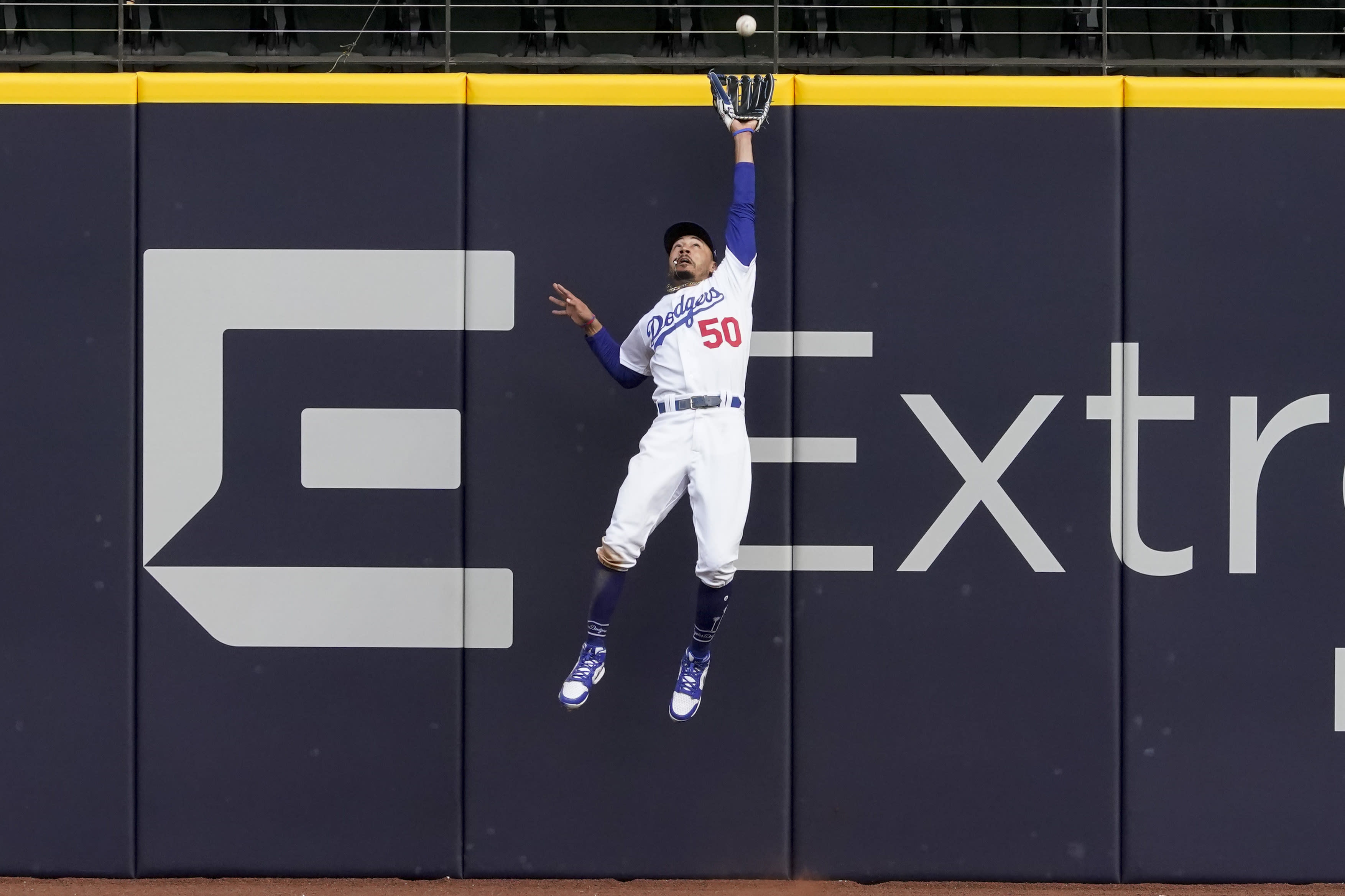 Los Angeles Dodgers right fielder Mookie Betts robs Atlanta Braves' Marcell Ozuna of a home during the fifth inning in Game 6 of a baseball National League Championship Series Saturday, Oct. 17, 2020, in Arlington, Texas. (AP Photo/Tony Gutierrez)