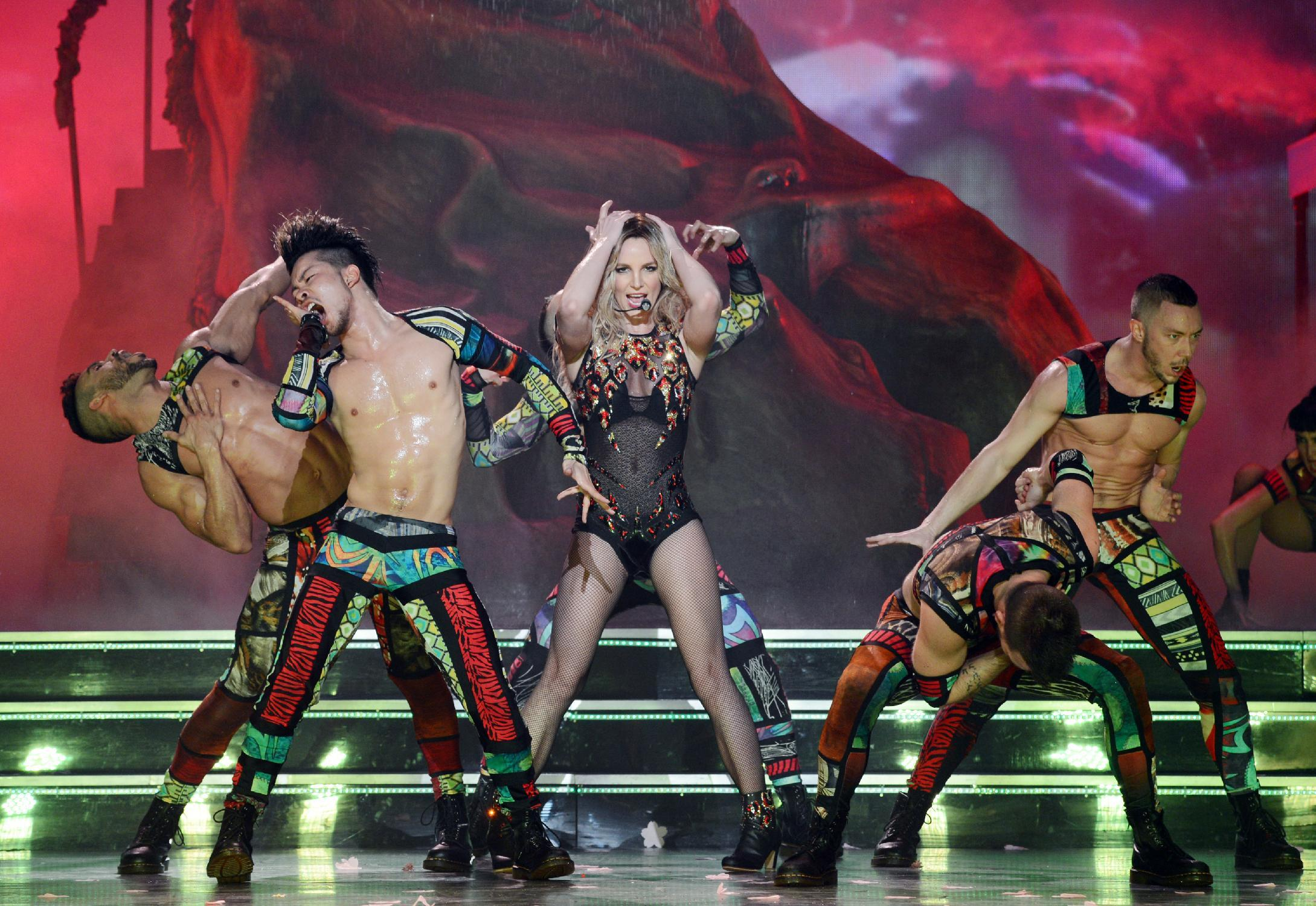 """In this photo provided by Caesars Entertainment, Britney Spears rehearses """"Britney: Piece of Me"""" at Planet Hollywood Resort & Casino on Thursday, Dec. 26, 2013, in Las Vegas. Spears began her two-year a Las Vegas casino residency Friday. (AP Photo/Caesars Entertainment, Denise Truscello)"""