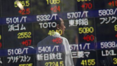 Asian shares off 10-year peak, eyes on China