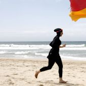 Photos show French police making a woman take off her blouse on a beach where burkinis are banned