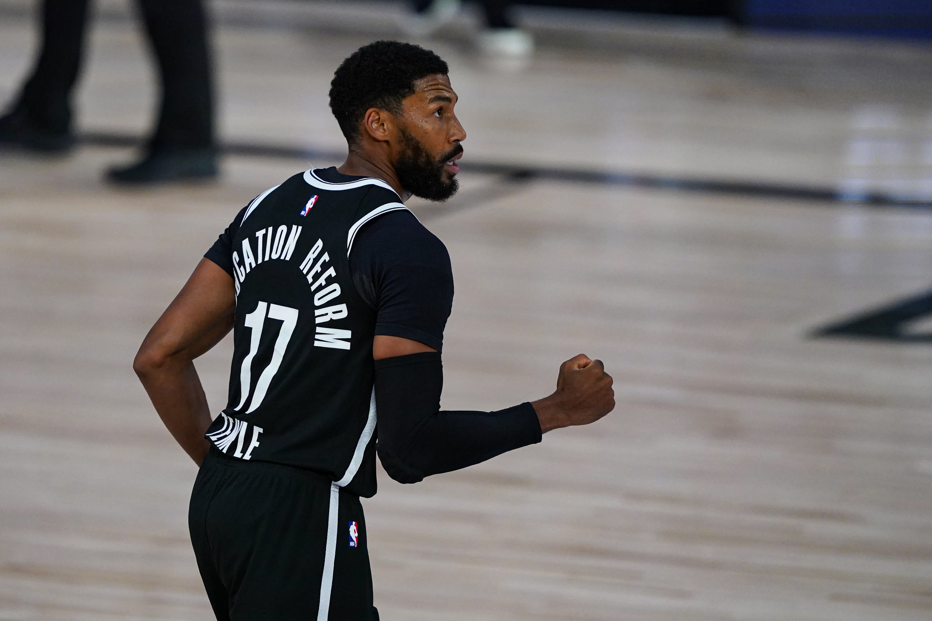 Brooklyn Nets guard Garrett Temple (17) celebrates three-point basket in the closing seconds to defeat the Milwaukee Bucks 119-116 in an NBA basketball game Tuesday, Aug. 4, 2020 in Lake Buena Vista, Fla. (AP Photo/Ashley Landis)