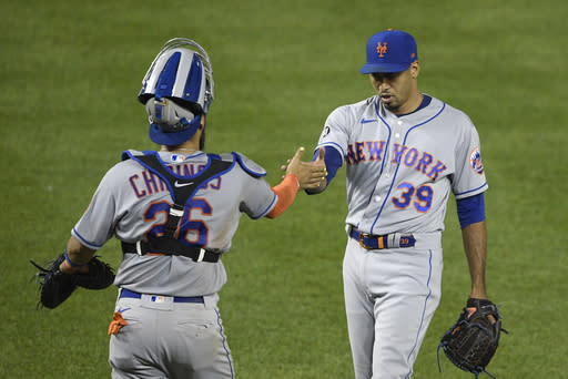 New York Mets relief pitcher Edwin Diaz (39) and catcher Robinson Chirinos, left, celebrate after a baseball game against the Washington Nationals, Thursday, Sept. 24, 2020, in Washington. The Mets won 3-2. (AP Photo/Nick Wass)