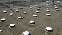 Oil plunge sets off search for tanks, revives dormant Cushing storage trade