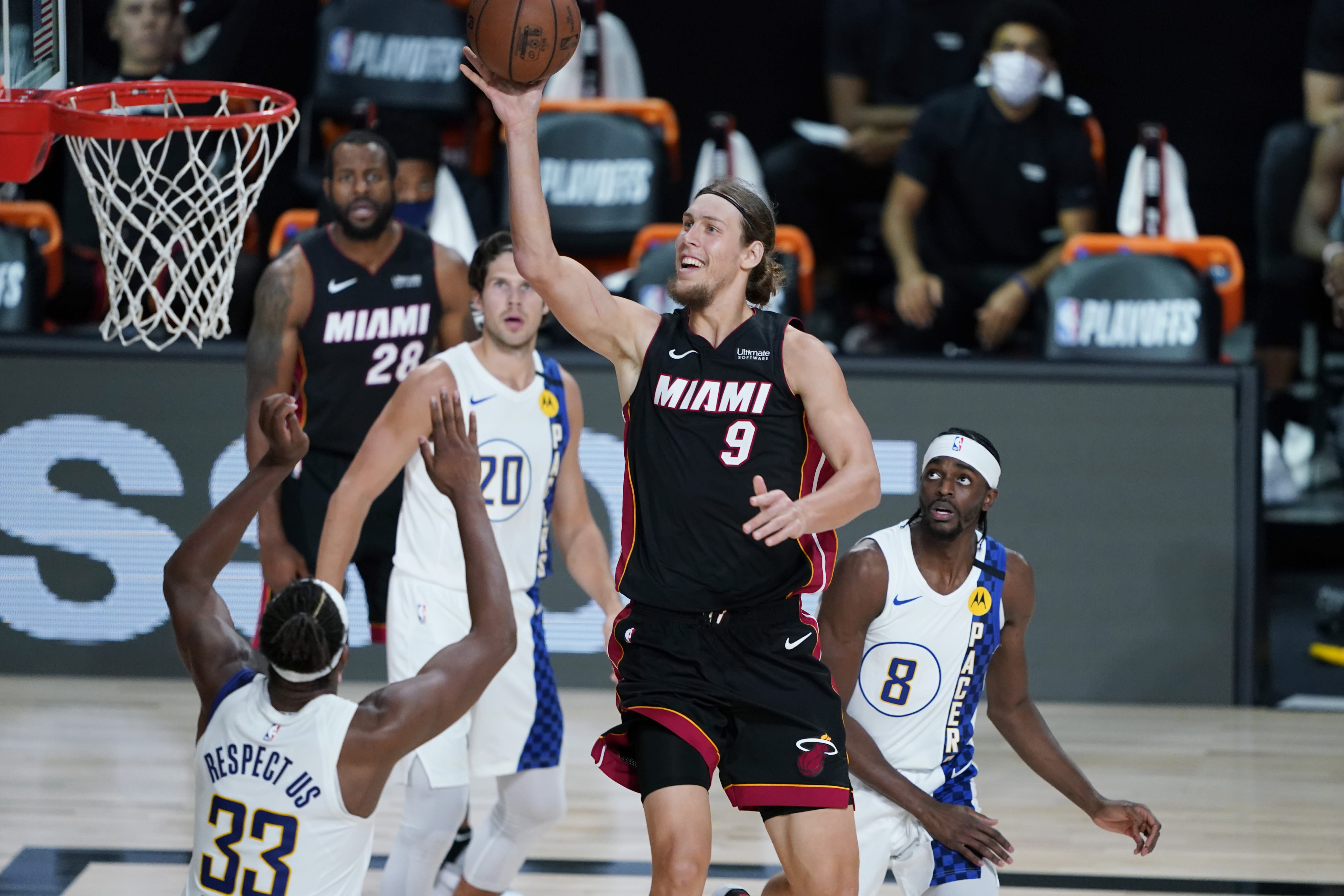 Miami Heat forward Kelly Olynyk (9) shoots over Indiana Pacers center Myles Turner (33) during the second half of an NBA basketball first round playoff game, Saturday, Aug. 22, 2020, in Lake Buena Vista, Fla. (AP Photo/Ashley Landis, Pool)