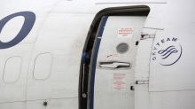 'Mentally disturbed' passenger tries to open plane door during flight
