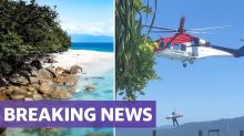 Young woman mauled by shark off Cairns coast