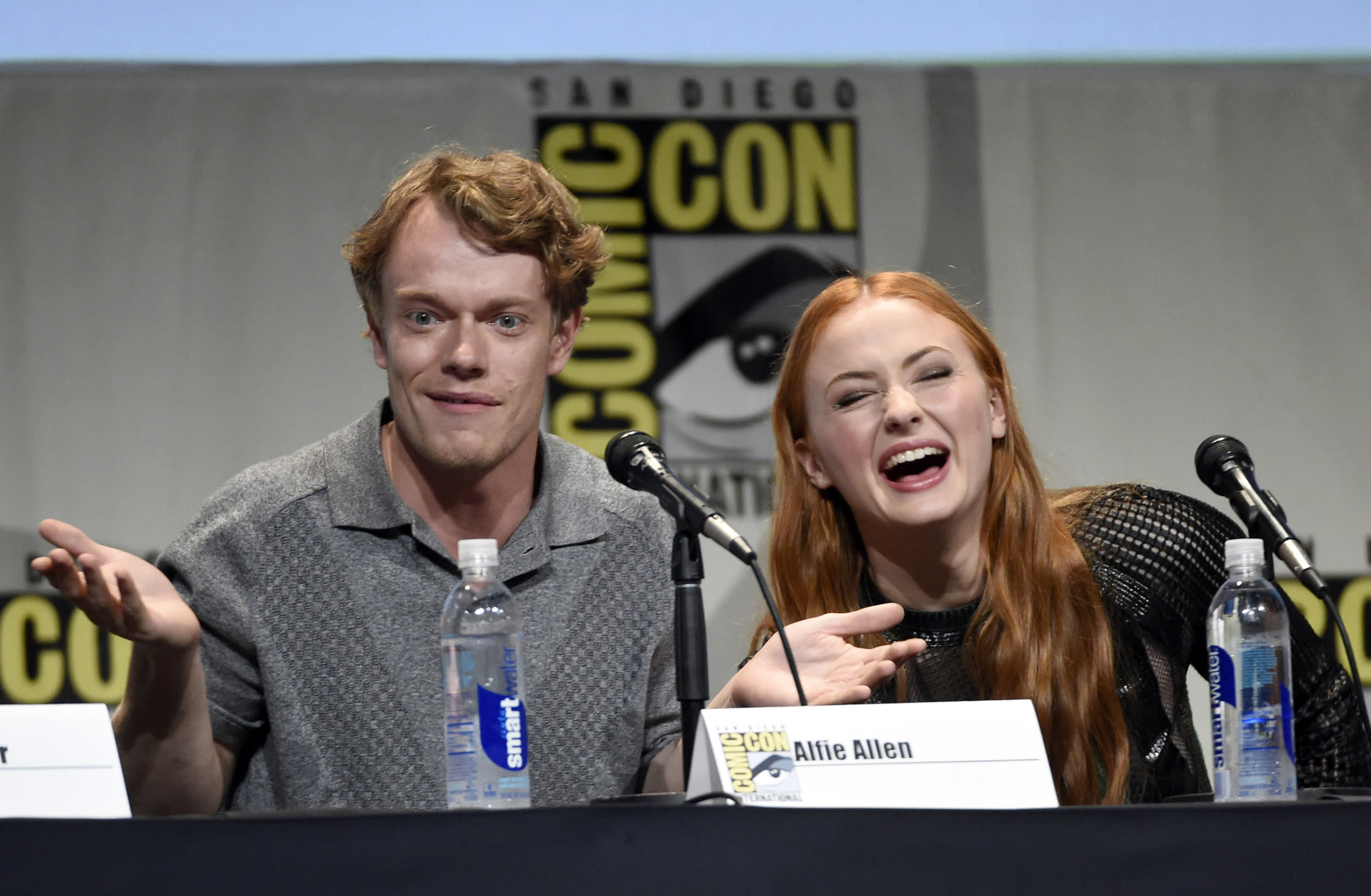 """Alfie Allen, left, and Sophie Turner attend the """"Game of Thrones"""" panel on day 2 of Comic-Con International on Friday, July 10, 2015, in San Diego, Calif. (Photo by Chris Pizzello/Invision/AP)"""
