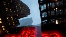 North American stock markets down in late-morning trading, loonie lower