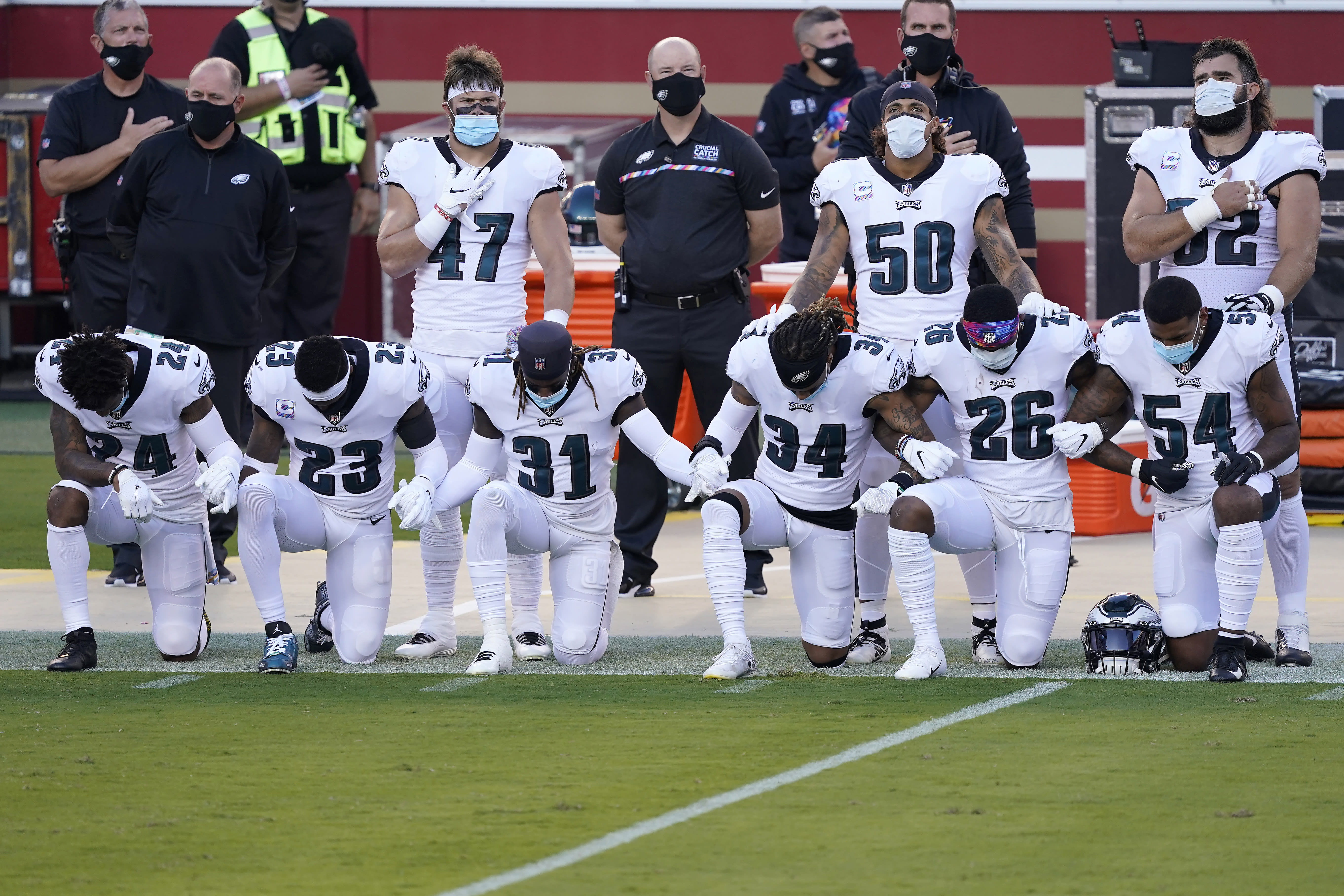 Philadelphia Eagles' Darius Slay, from bottom left, kneels with Rodney McLeod, Nickell Robey-Coleman, Cre'von LeBlanc, Miles Sanders and Shaun Bradley during the national anthem before an NFL football game in Santa Clara, Calif., Sunday, Oct. 4, 2020. (AP Photo/Tony Avelar)