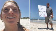 Tiktoker calls out stranger holding 'creepy' sign at women on beach